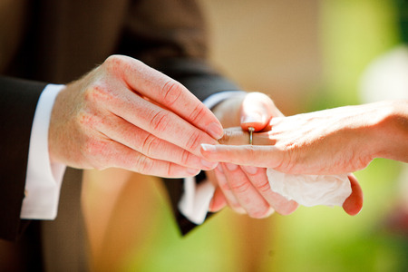 Bride and groom with wedding rings photo