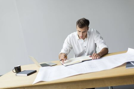 architect office: Young man in the office Stock Photo