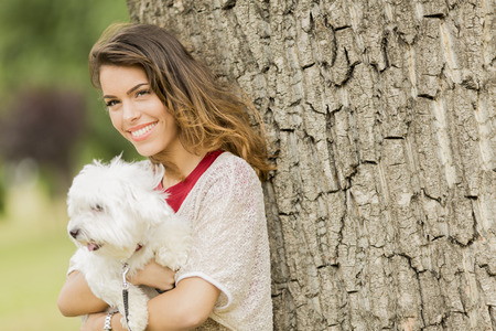 maltese dog: Young woman with a maltese dog Stock Photo