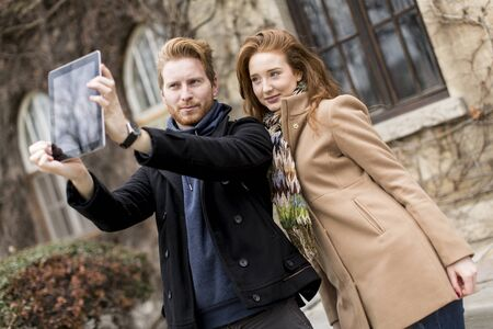 affectionate actions: Young couple taking photo with tablet Stock Photo