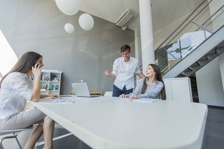 attractive office: Young people in the office Stock Photo