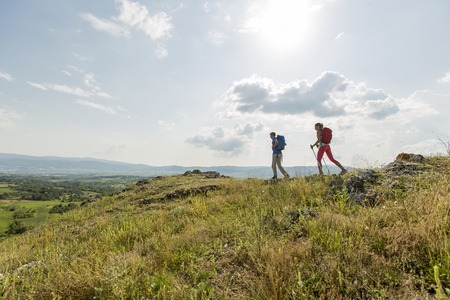 landscape rural: Young couple hiking on the mountain Stock Photo