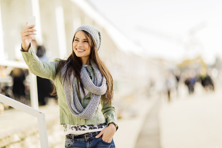 Young woman taking selfie on the street Stock fotó