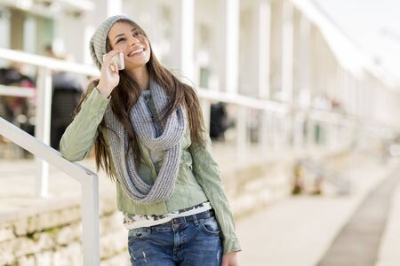 woman on phone: Young woman with mobile phone