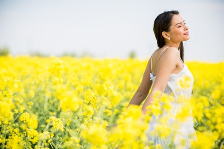 flowers field: Young woman in the spring field
