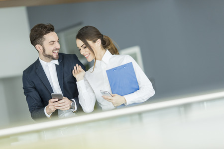 Young couple working in the office Banco de Imagens