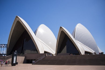 utzon: SYDNEY, AUSTRALIA - FEBRUARY 12, 2015: View at Sidney opera house in Sydney, Australia. It was Designed by Danish architect Jorn Utzon and was opened at October 20, 1973.