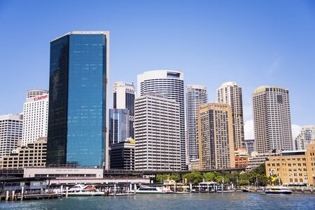 SYDNEY, AUSTRALIA - FEBRUARY 12, 2015: Modern skyscrapers in Sydney, Australia. Sydney is the state capital of New South Wales and the most populous city in Australia.