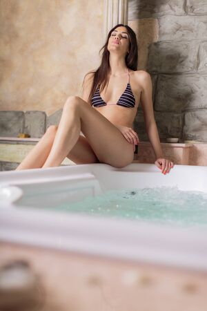 relaxion: Pretty young woman relaxing in the hot tub