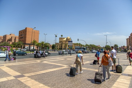 endpoint: MARRAKESH, MOROCCO - SEPTEMBER 11, 2014: Unidentified people in front of train station in Marrakesh, Morocco. Train station was opened on August 10, 2008 and now is southern end-point of the Moroccan railway system. Editorial