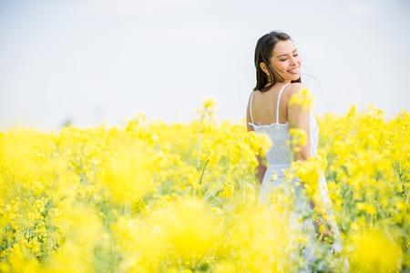 field flower: Young woman in the spring field