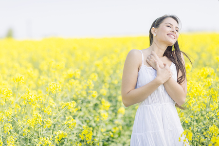 freedom woman: Young woman in the spring field