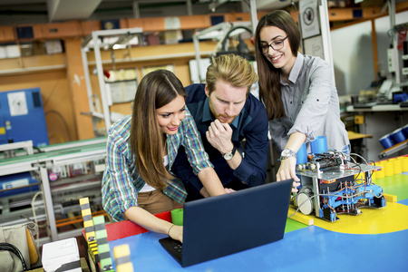 electrical component: Young people in the robotics classroom