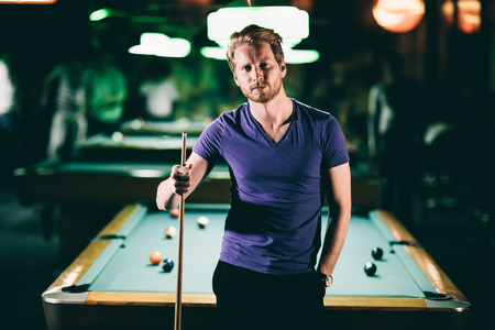 billiards rooms: Young man playing pool