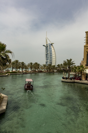 DUBAI, UAE - MAY 8, 2015: Unidentified people at Madinat Jumeirah in Dubai. Madinat Jumeirah encompasses two hotels and clusters of 29 traditional Arabic houses.