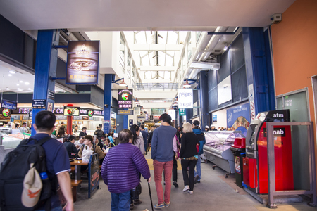 tonnes: SYDNEY, AUSTRALIA - APRIL 9, 2015: Unindefinited people on the Sydney Fish Market. 52 tonnes of seafood are selling at auction on this market every day.