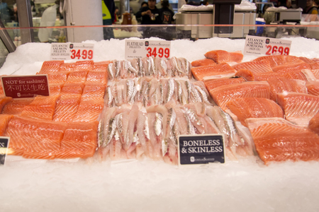 tonnes: SYDNEY, AUSTRALIA - APRIL 9, 2015: Fishes on the Sydney Fish Market. 52 tonnes of seafood are selling at auction on this market every day. Editorial