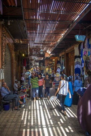souk: MARRAKESH, MOROCCO - SEPTEMBER 13, 2014: Unidentified people at souk in Marrakesh, Morocco. Marrakesh has the largest traditional Berber market (souk) in Morocco.