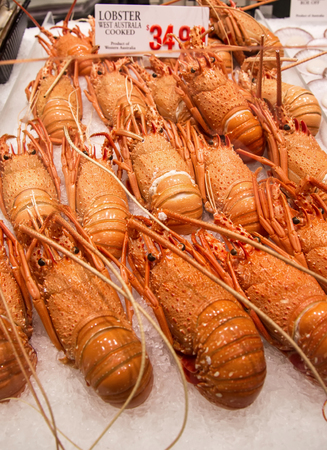 lobster tail: SYDNEY, AUSTRALIA - APRIL 9, 2015:  Lobster on the Sydney Fish Market. 52 tonnes of seafood are selling at auction on this market every day. Editorial