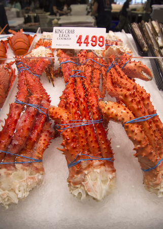 tonnes: SYDNEY, AUSTRALIA - APRIL 9, 2015: King crab legsr on the Sydney Fish Market. 52 tonnes of seafood are selling at auction on this market every day. Editorial