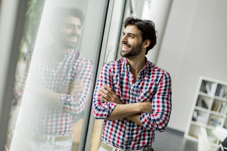 casual business man: Young man in the office Stock Photo