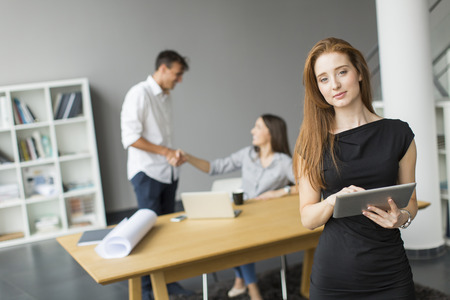 corporate women: Young people in the office Stock Photo