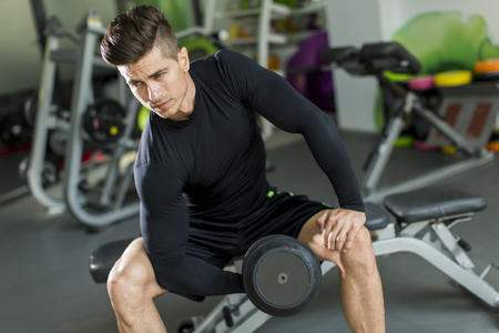 workout gym: Young man training in the gym