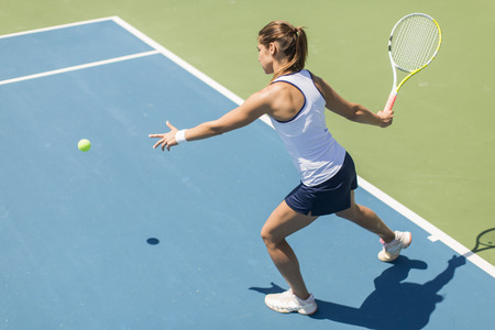 girl action: Young woman playing tennis