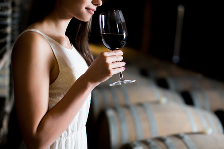 Young woman in the wine cellar Banco de Imagens - 49275506