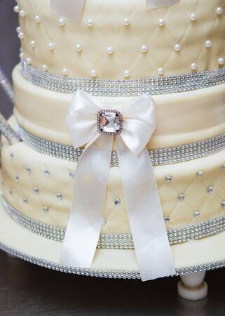 wedding cake: View at the white wedding cake Stock Photo