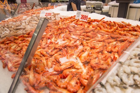 tonnes: SYDNEY, AUSTRALIA - APRIL 9, 2015: Prawn on the Sydney Fish Market. 52 tonnes of seafood are selling at auction on this market every day.