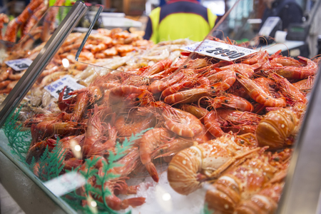 tonnes: SYDNEY, AUSTRALIA - APRIL 9, 2015: Prawns on the Sydney Fish Market. 52 tonnes of seafood are selling at auction on this market every day.