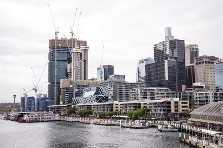 darling: SYDNEY, AUSTRALIA - APRIL 9, 2015: Modern skyscrapers at Darling Harbour in Sydney, Australia. Darling Harbour is home to a number of major public facilities and attractions Editorial