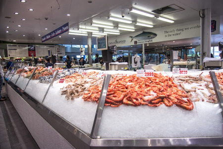 SYDNEY, AUSTRALIA - APRIL 9, 2015: Seafood on the Sydney Fish Market. 52 tonnes of seafood are selling at auction on this market every day. Редакционное