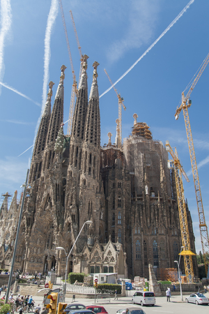 anticipated: BARCELONA, SPAIN - JUNE 24, 2010: View of Sagrada Familia church in Barcelona, Spain. Construction of Sagrada Familia had started in 1882 and an anticipated completion date is at 2026.