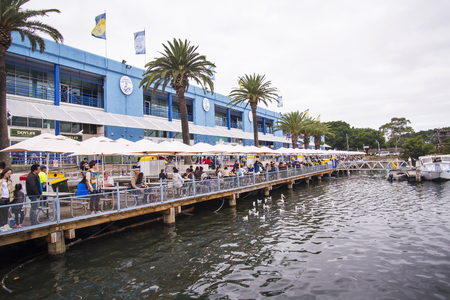 tonnes: SYDNEY, AUSTRALIA - APRIL 9, 2015: Unidentified people by the Sydney Fish Market. 52 tonnes of seafood are selling at auction on this market every day.