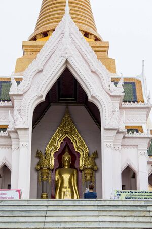 nakhon: NAKHON PATHOM, THAILAND - AUGUST 21, 2014: Unidentified people at Phra Pathommachedi stupa in Nakhon Pathom, Thailand. At 120.5 metres it is the tallest stupa in the world.