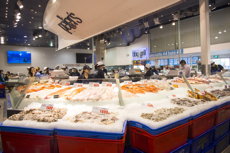 tonnes: SYDNEY, AUSTRALIA - APRIL 9, 2015: Unidentifined peopleon the Sydney Fish Market. 52 tonnes of seafood are selling at auction on this market every day.