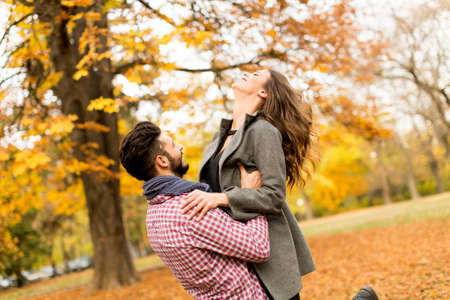 autumn young: Young couple in the autumn park