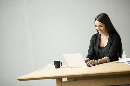 people: Young woman working in the office Stock Photo