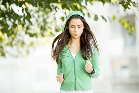 Young woman running in the park Stock Photo