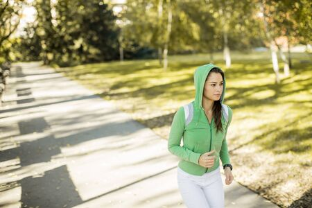 fitness training: Young woman running in the park Stock Photo