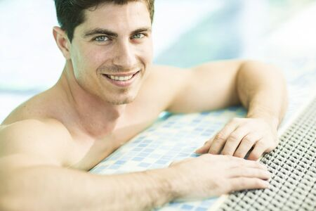 white face: Young man in the swimming pool