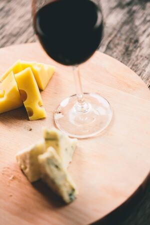 glass table: Cheese and glass of  red wine on salver