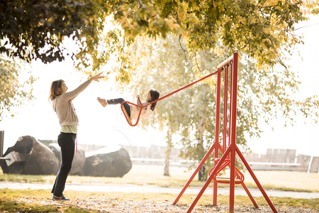 child sport: Little girl and young woman on the playground