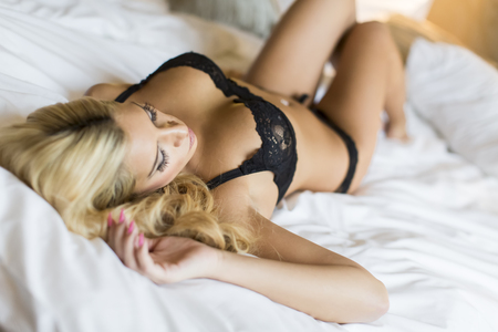 nude sexy woman: Pretty young woman laying on the bed Stock Photo