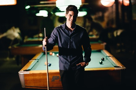 snooker rooms: Young man playing pool