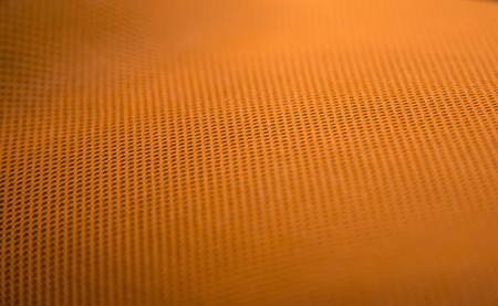 netlike: Closeup of the orange metal pattern