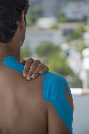 adhesive bandage: Adhesive bandage on shoulder