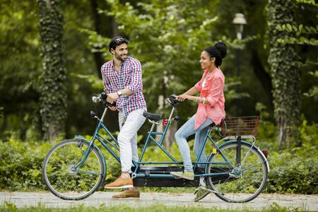 affectionate action: Young couple riding on the bicycle
